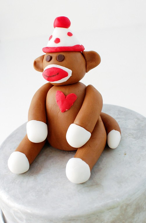 Sock monkey cake topper made from fondant