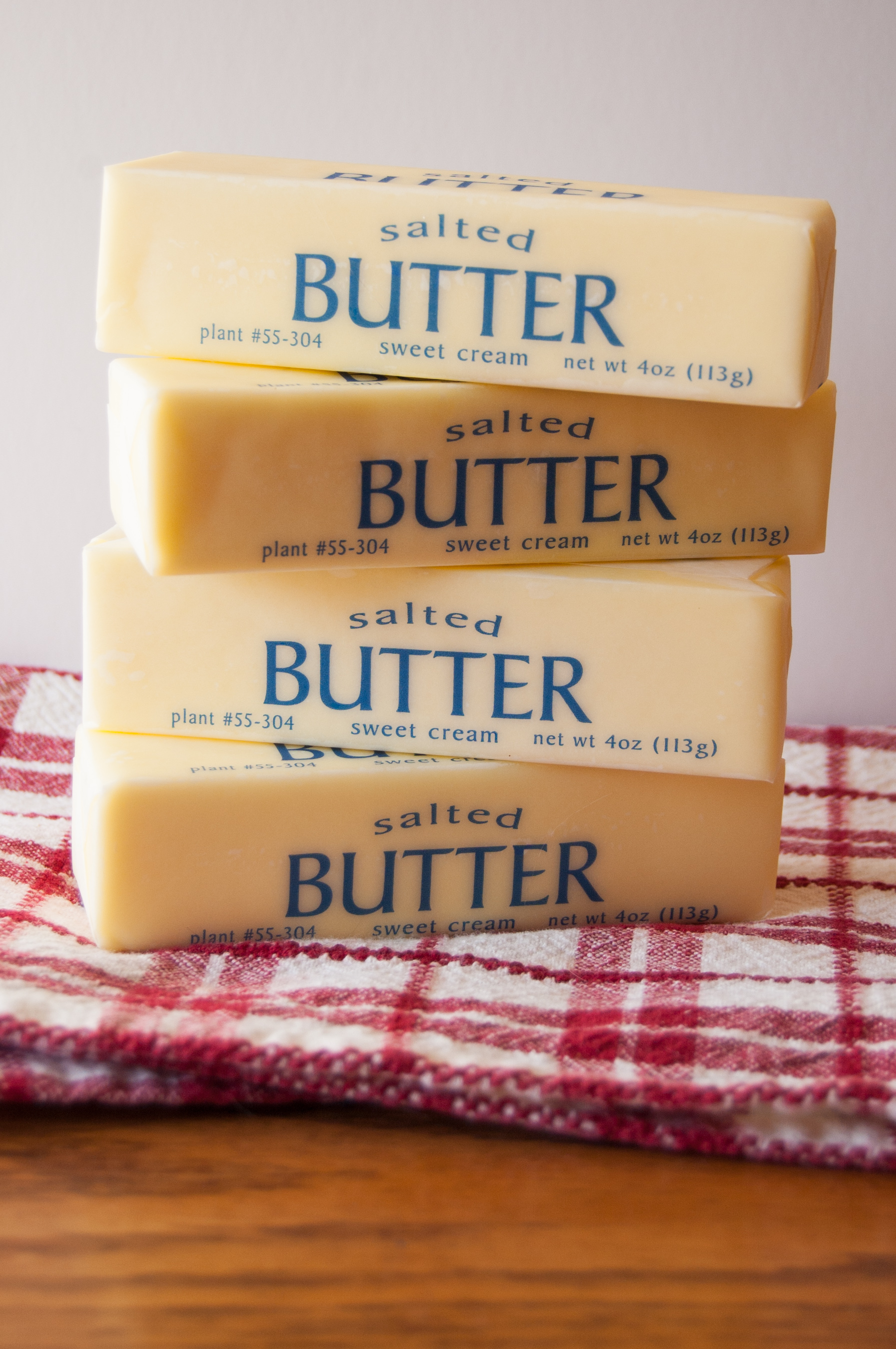 Stack of softened butter on a red checked cloth