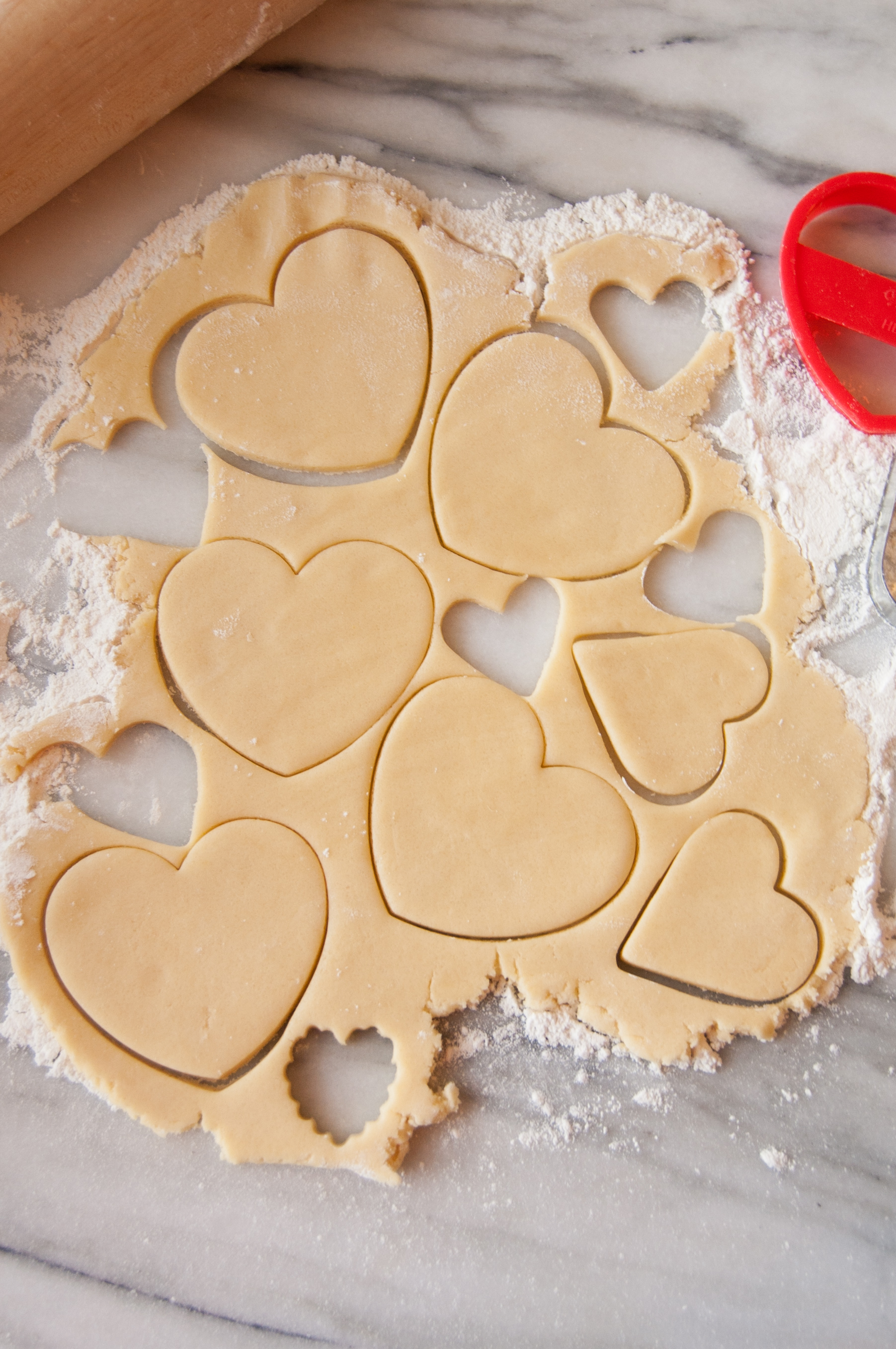 Sugar Cookie dough rolled out with hearts cut out
