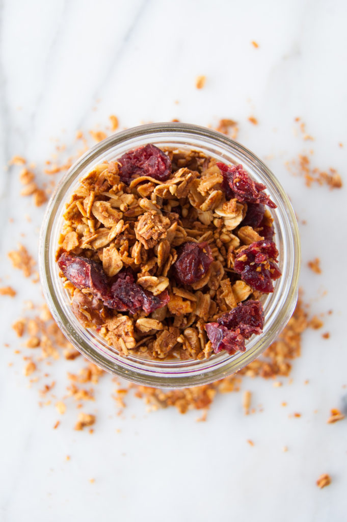 Jar of granola with dried cranberries
