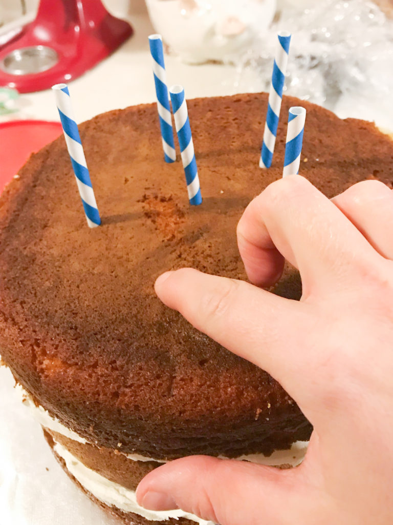 push straw down into cake
