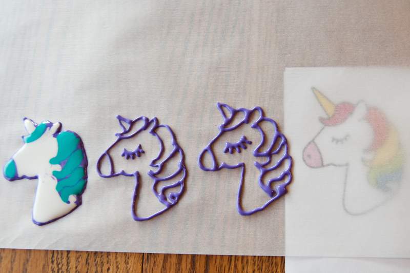Piping the unicorn toppers