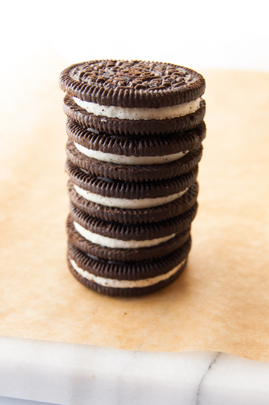 Stack of oreos ready to dip in chocolate