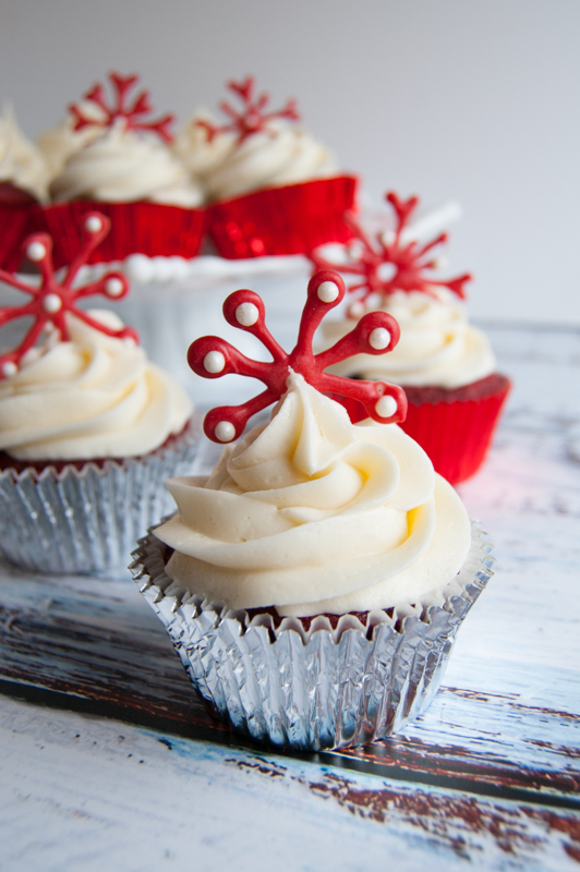 Red Velvet Cupcakes with Cream Cheese Frosting and a white chocolate snowflake