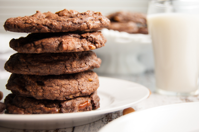 Turtle brownie cookies in a stack