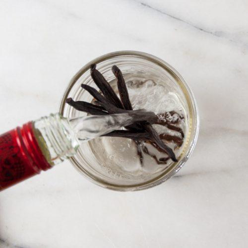 pour vodka over the split vanilla beans