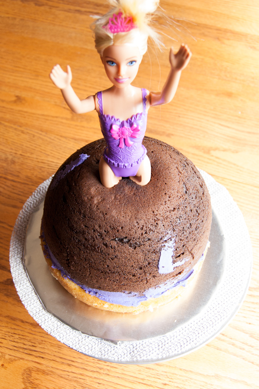 putting barbie in the cake