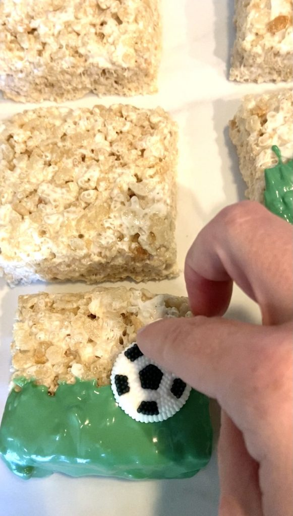 adding the soccerball to the rice kripie treat
